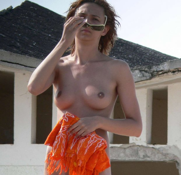 Confident older woman taking a nude walk outdoors