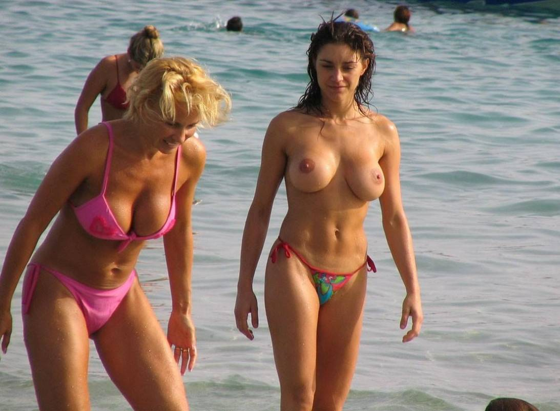 Hot topless brunette with a tight body at the beach with her still hot mom