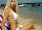 Hot barbie blond sporting a white bikini on the beach