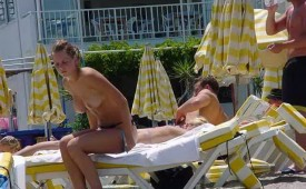 21338-Cute-blonde-finishing-up-her-topless-tanning-session.jpg