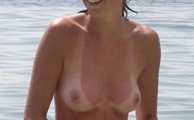 21341-Cute-pixie-haired-babe-swimming-nude.jpg