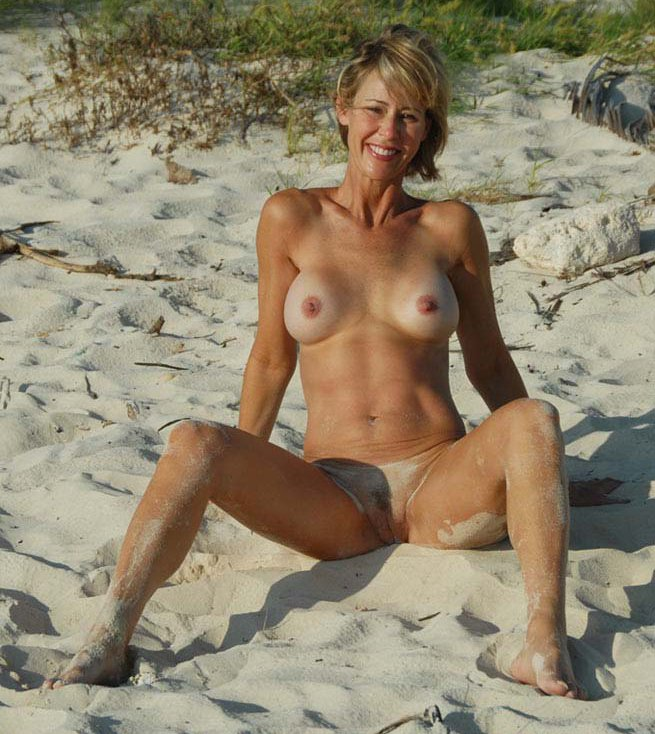 Sexy blonde fox showing it all off on the beach