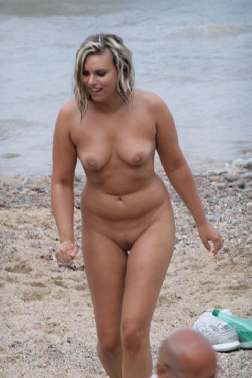 Cute blonde enjoying the beach in her birthday suit
