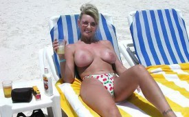 21393-Mature-mama-going-topless-on-the-beach.jpg
