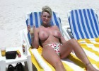 Mature mama going topless on the beach