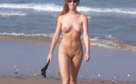 21841-Fully-nude-hottie-going-for-a-stroll-by-the-ocean.jpg