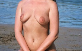 21844-Hot-nude-brunette-enjoying-the-beach.jpg