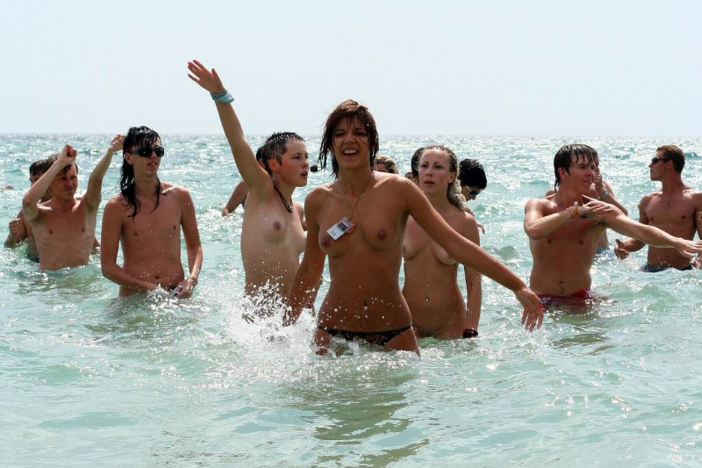 Topless babe in the water flashing their tits