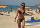 Sensual teen dressed in black bikinis