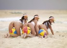 Three hot brunettes baring their pussies on the beach