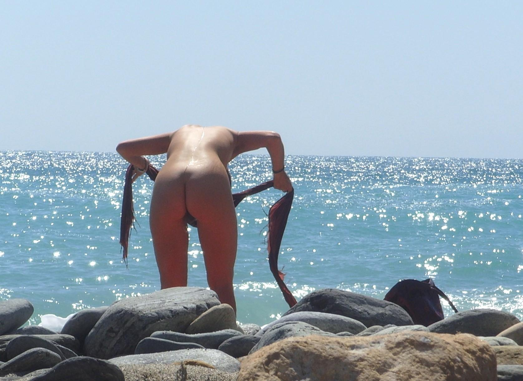 Amazing view with blue ocean and nude babe