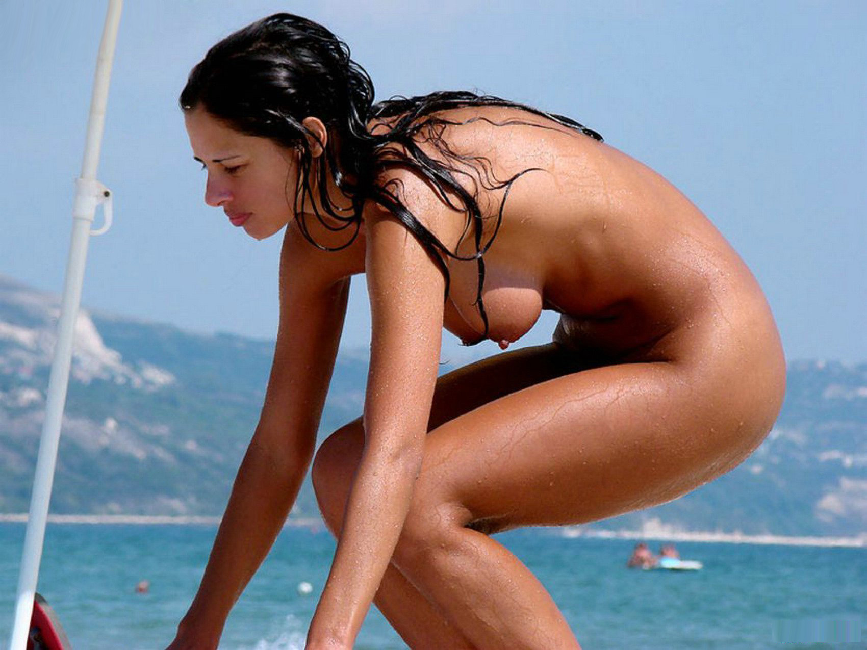 Nude babe out of the sea