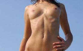 24838-Smokin-hot-redhead-fully-nude-outdoors.jpg
