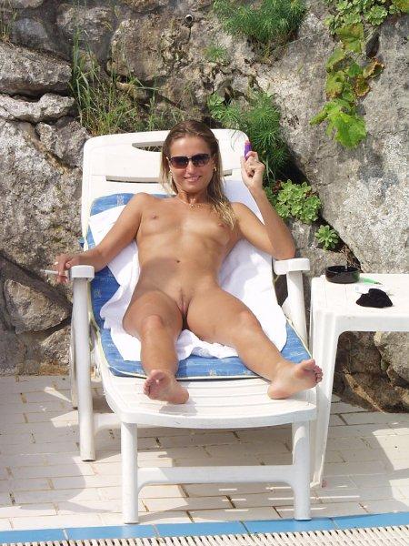 Spunky older blonde tanning fully nude