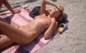 24861-Sleeping-naked-on-the-beach.jpg