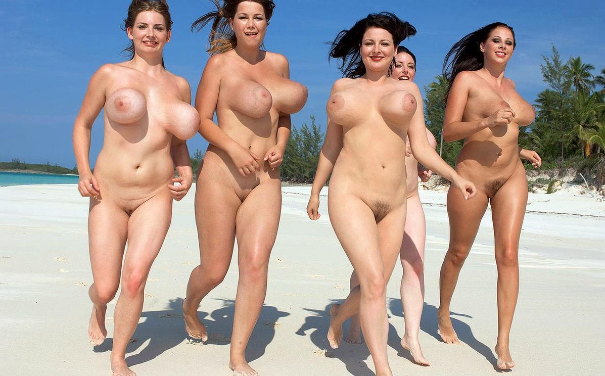 Naked women running on beach