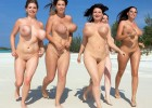 Voluptuous ladies running on the beach