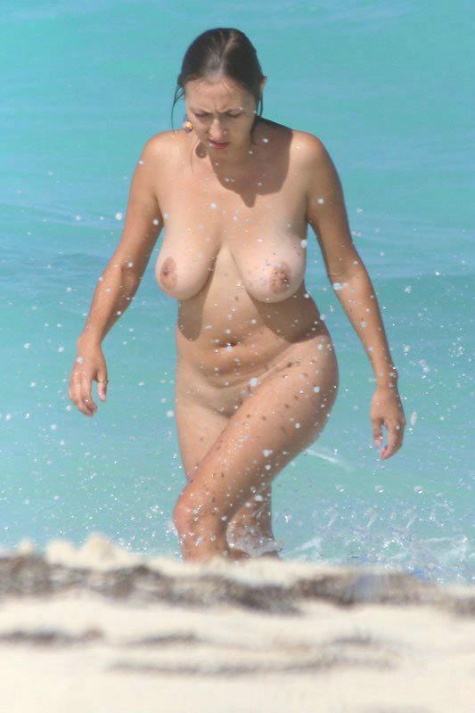 Confident older woman enjoying a day at the nude beach