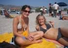 Cute teen girls posing sexily on the beach