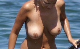 124-Hot-blonde-swimming-topless.jpg