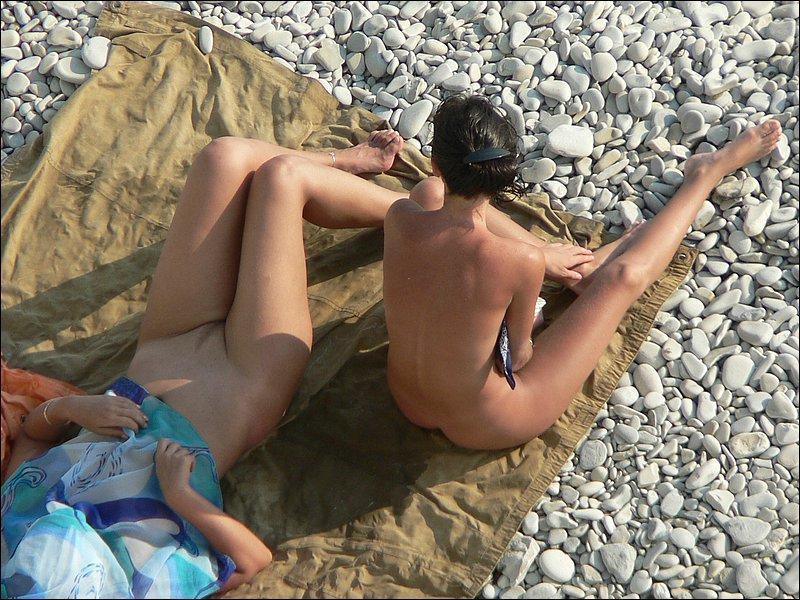 Naked girls exposed on a rocky beach