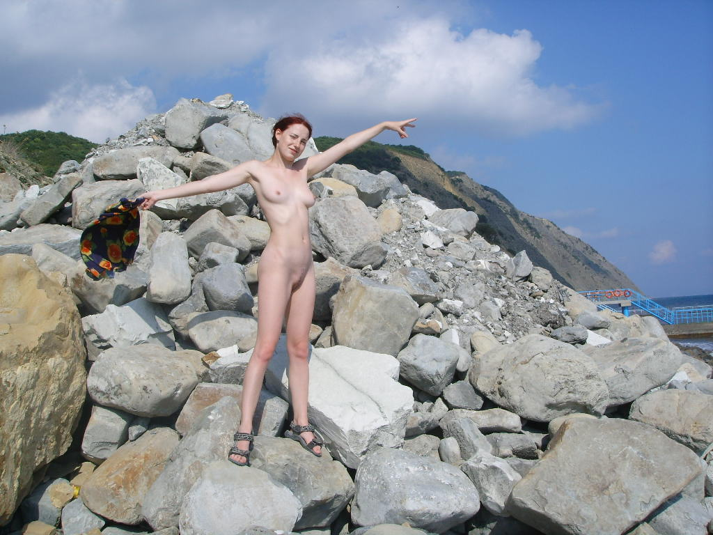 Nude girlfriend on a rocky beach