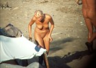 Nude girl exposed by voyeurs walking on the beach