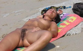 289-Sleeping-babe-expose-her-hairy-slit-in-public.jpg