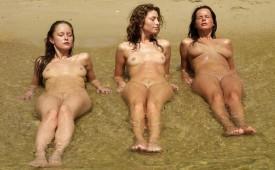 324-Three-nude-mermaids-laying-in-the-water.jpg