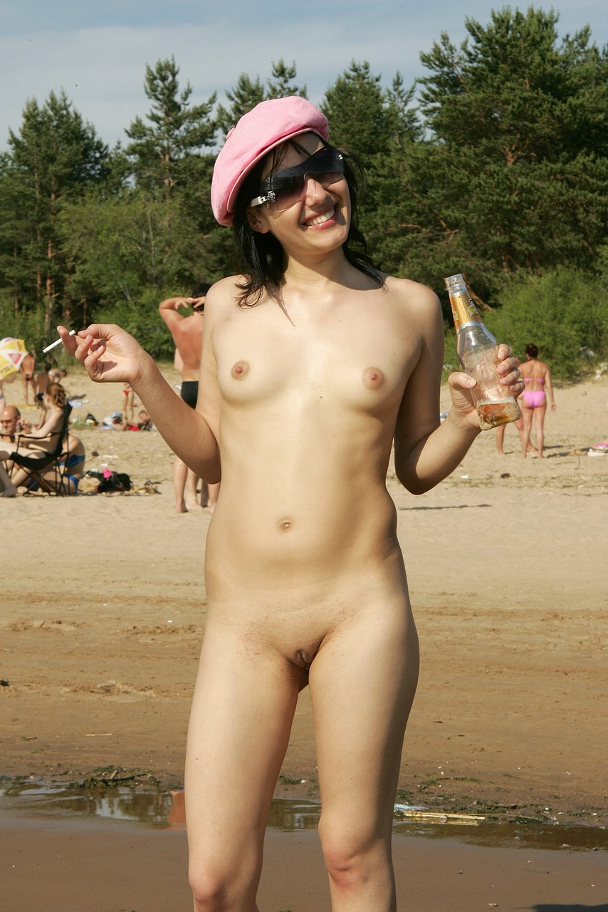 Nude happy girl enjoying a hot day at beach