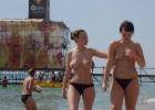 Two hot teens walking on the beach topless