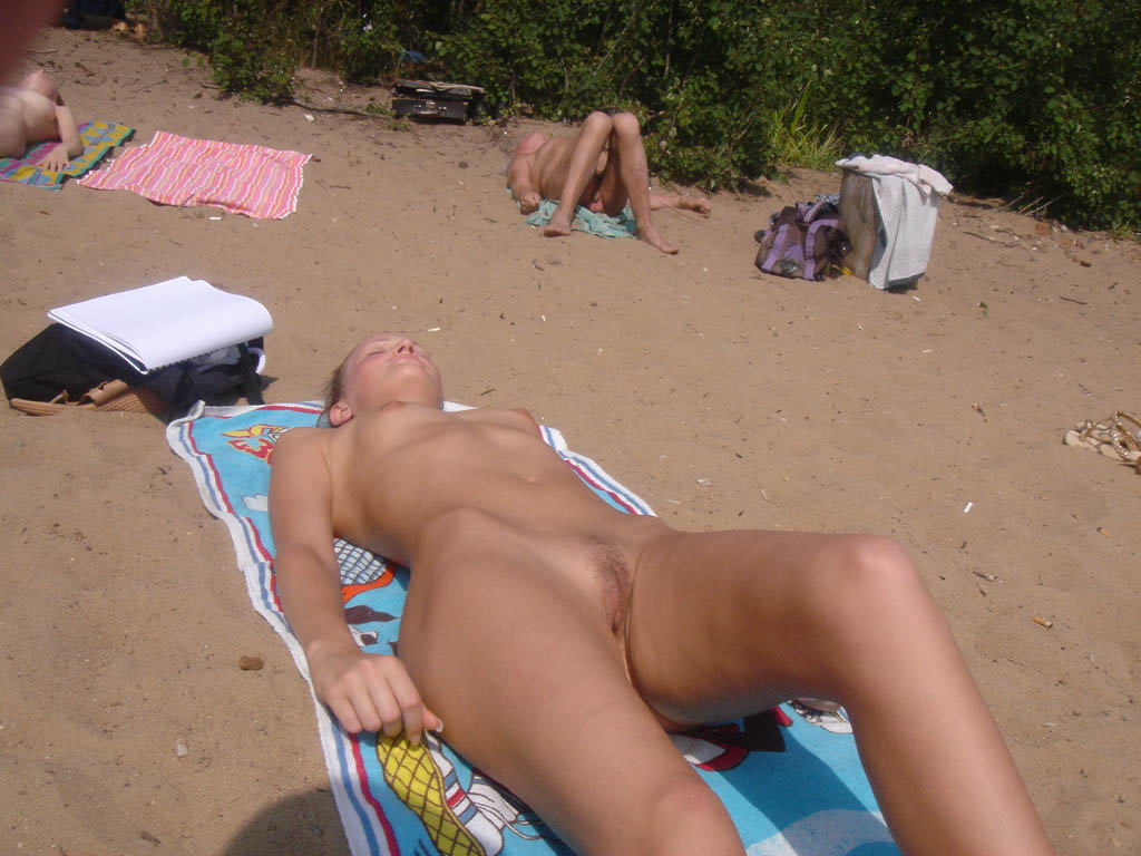 Fully nude suntanning in public
