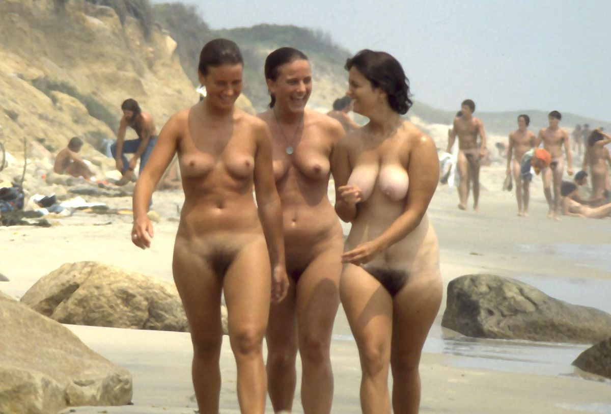 Gorgeous nude babes revealing their hairy muffs at the beach