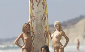 644-Hot-babes-posing-nude-with-a-huge-surfing-board.jpg