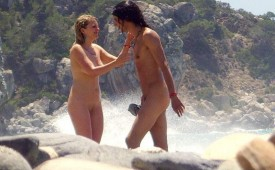 690-Naked-couple-showing-affection-on-the-beach.jpg