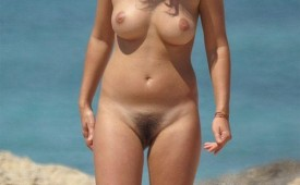 692-Middleaged-mama-showing-off-her-hairy-puss-at-the-beach.jpg
