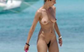 21235-Hairy-pussy-babe-and-slippery-body-near-the-ocean.jpg