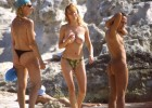 A group of friends enjoying the beach in various stages of undress