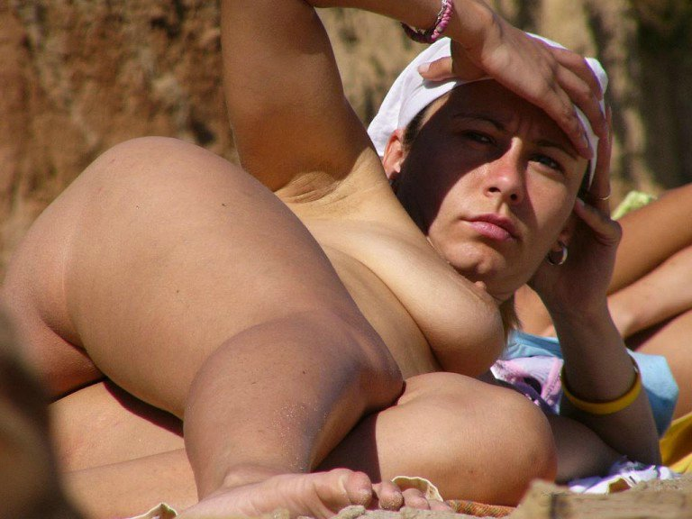 Nude girlfriend tanning her awesome body