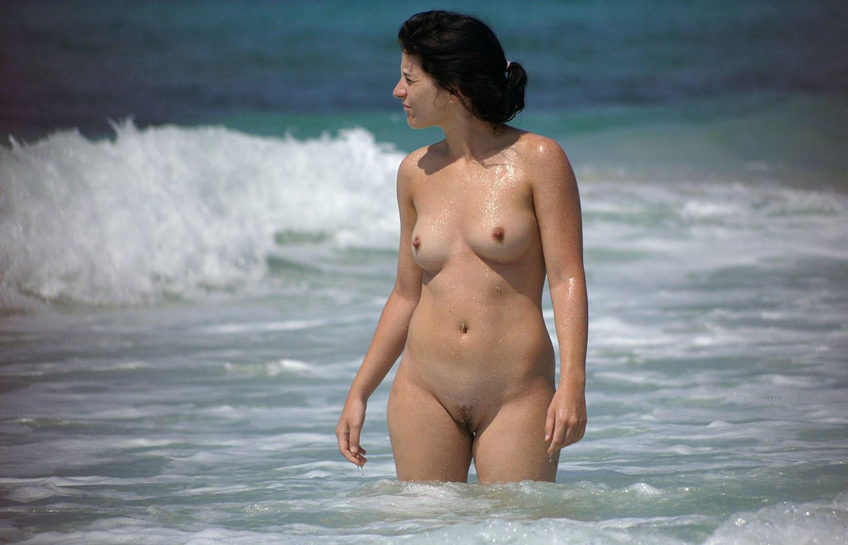 Sexy naked older gal enjoying the surf and waves