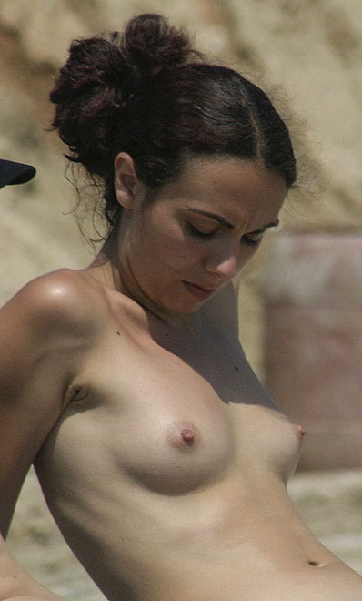 Sexy topless babe checking out her rack