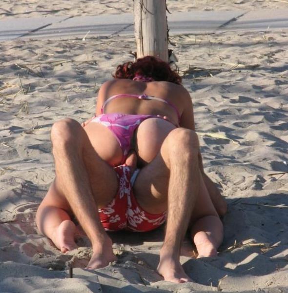 Beach couple getting naughty