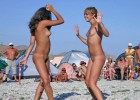 Nude babes dancing on the warm beach