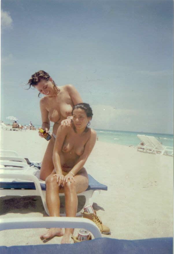 Naughty naked girls prepares for tanning