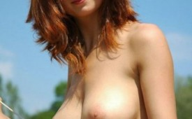 129-Hot-mature-ginger-taking-her-top-off.jpg