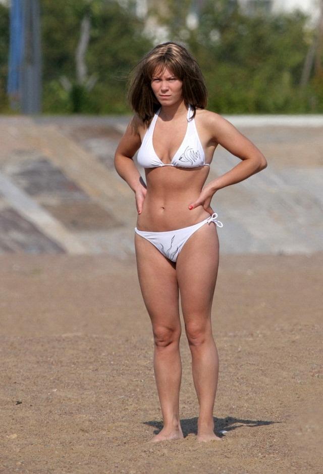 Hot wife exposed on the beach wearing white bikinis