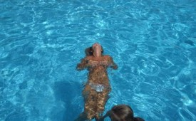 157-Naked-beauty-swimming-topless-in-the-pool.jpg