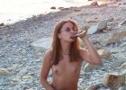 Nude girlie energizing with a shot