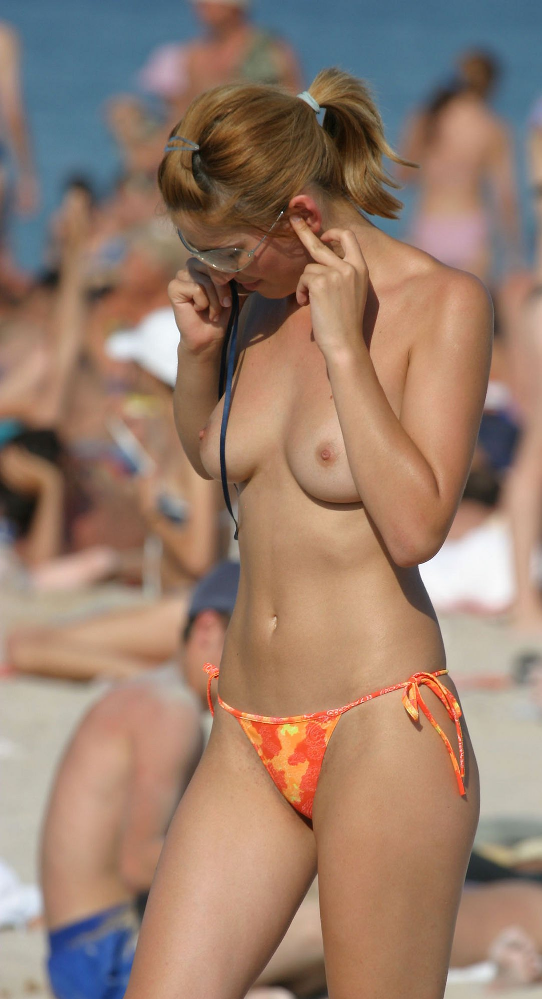 Sensual topless hottie caught by indiscreet photo cam