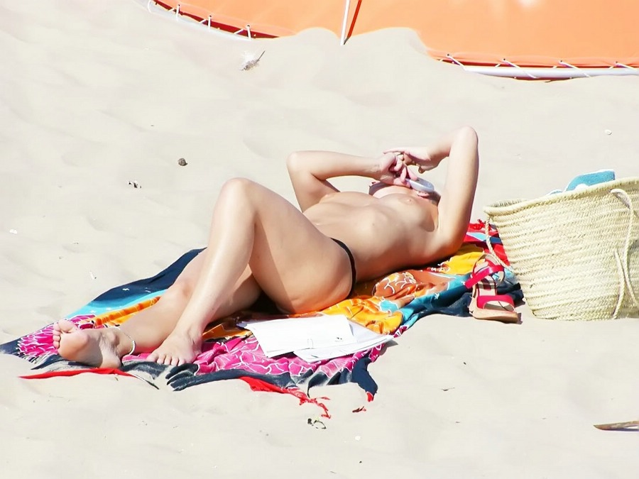 Topless girl trying to have a nap